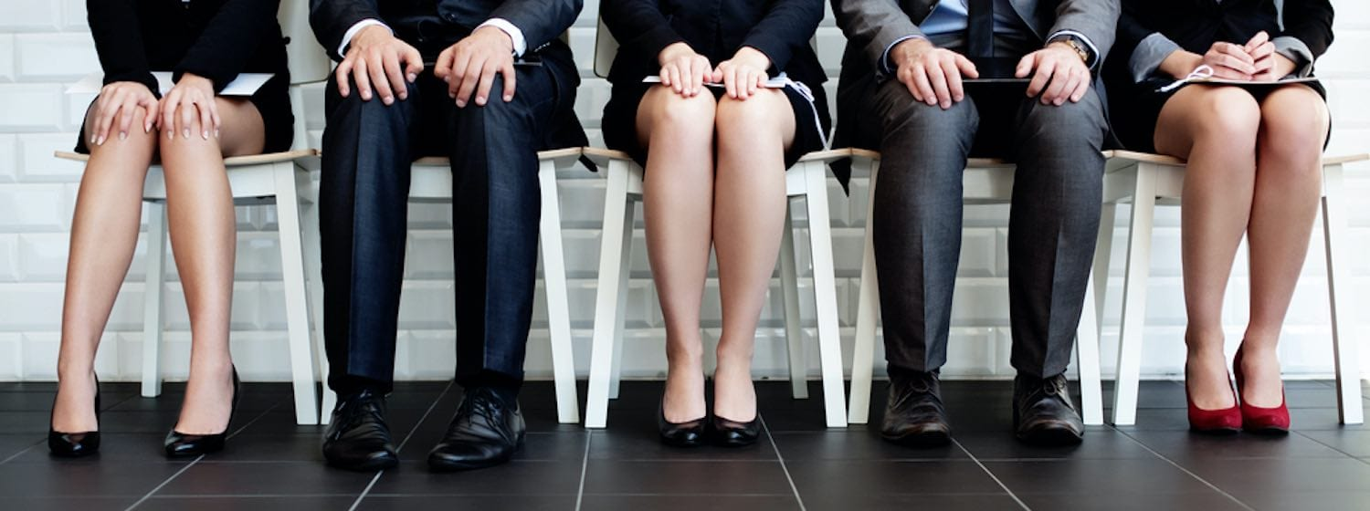 Professionals sitting waiting for job interview