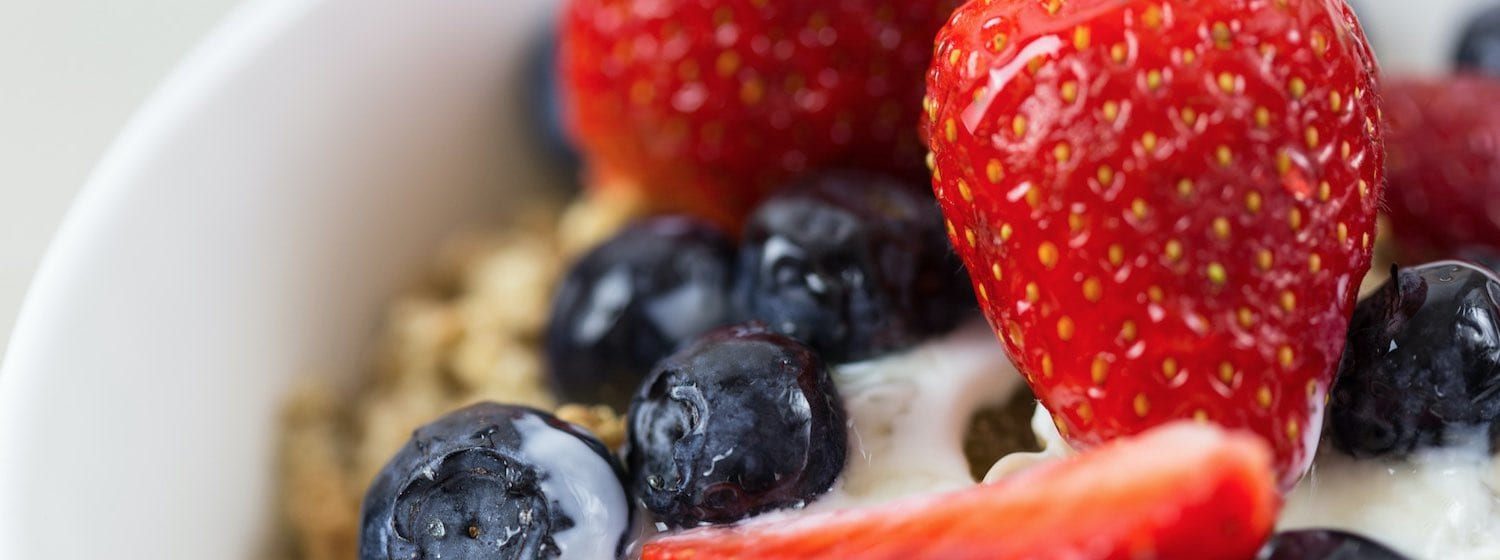Healthy snacks strawberries blueberries and nuts